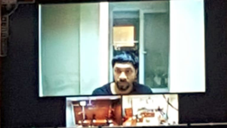 Long road: Prakash appears on a video screen during a court appearance in Turkey.