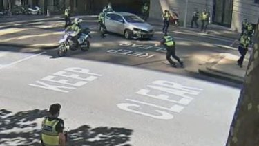 An image from CCTV showing police trying to stop Siyar Bagdas