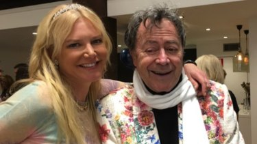 A tiara-clad Lizzie Buttrose and Charles Billich enjoying the launch of Geniale.
