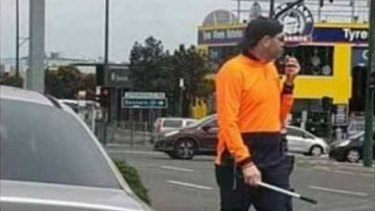 A Melbourne resident has uploaded this picture to social media, claiming the man was a police officer pretending to be a window washer.