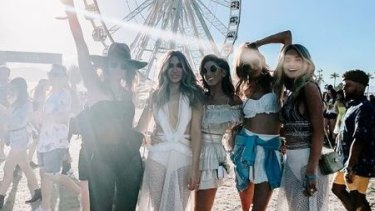 Bec posed alongside her army of glamorous WAGs including Nadia Bartel (second left), Lana Wilkinson and Jessie Murphy (far right) at the festival.