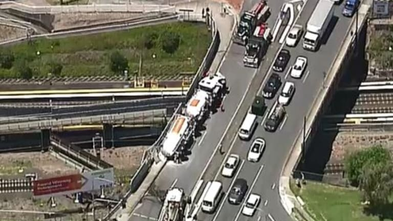 A truck rollover has caused delays at Dutton Park.