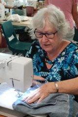 Reef Sister Pat sewing pyjamas.