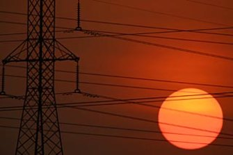 The operator of Australia's main power grid said extreme temperatures and bushfires pushed the system to the brink during the 2019-20 summer.