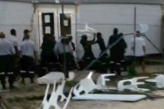 Stills from video of the day before the riot on Manus