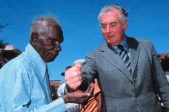Gough Whitlam pours sand into the hand of Vincent Lingiari in 1975.