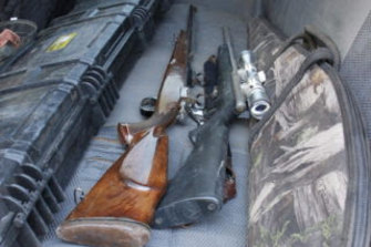 Some of the seven guns found in the back of a car being driven by the Mount Isa man.