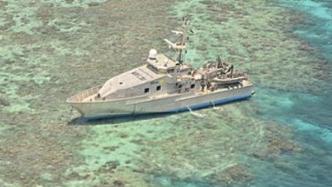 Defence Force patrol boat the Roebuck Bay gets stuck on the Great Barrier Reef off Port Douglas.