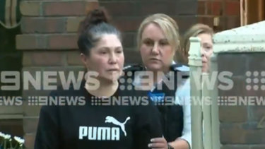 Roberta Williams was led away in handcuffs from her Strathmore home on Wednesday morning.