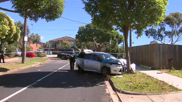 Police at the scene of the crash in Burwood on Tuesday.
