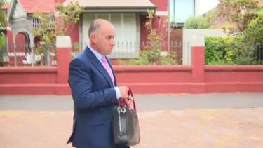 NAB CEO Andrew Thorburn heads to work on Tuesday morning.