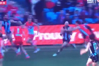 Collingwood star Steele Sidebottom is spun around in a tackle but 'play on' is the call.
