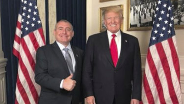 US President Donald Trump standing with Lev Parnas.