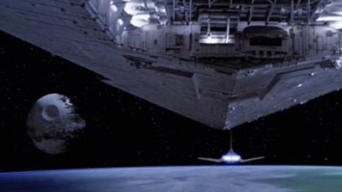 An Imperial Star Destroyer approaches the second Death Star in Return of the Jedi.