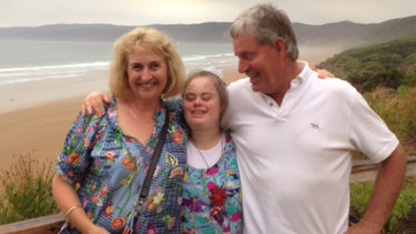 Anna Fisken, centre, with her parents Susie and Geoff. Anna has Down syndrome and has become more independent since taking part in the National Disability Insurance Scheme.