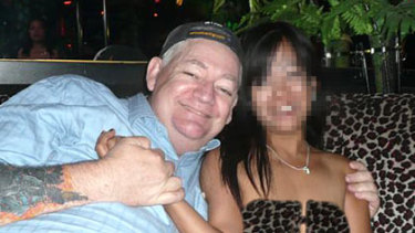 Terrence William Hainsworth relaxes in the Philippines with an unidentified woman.
