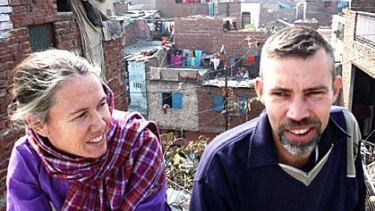 Mark and Cathy Delaney on the roof of their house in a Delhi slum in 2009
