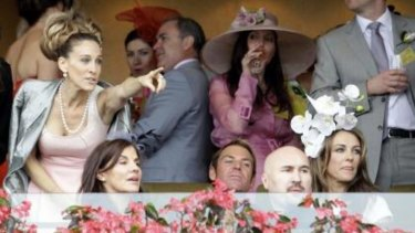 Sarah Jessica Parker (left) last visited Australia in 2011, when she watched the Oaks at Flemington alongside then couple Shane Warne and Elizabeth Hurley (right).