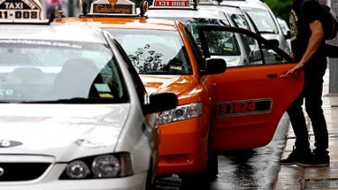 The value of taxi licences has plummeted since the introduction of Uber in Brisbane in 2014.