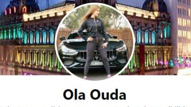 "In her Facebook profile picture, Oula Ouda stands in front of a Maserati with the number plate ""LBOSS""."