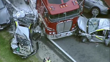Cars were crushed between the trucks on the Monash Freeway, but miraculously no one was seriously injured.