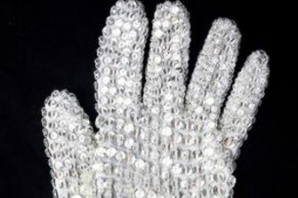 Michael Jackson's custom designed white spandex, right-hand glove completely covered in clear Swarovski crystal loch rosen crystals. Auction estimate: US$10,000 - $15,000.