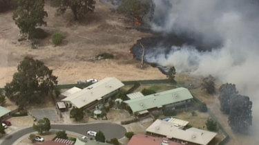 Fire from Plenty Gorge threatens home in Bundoora.
