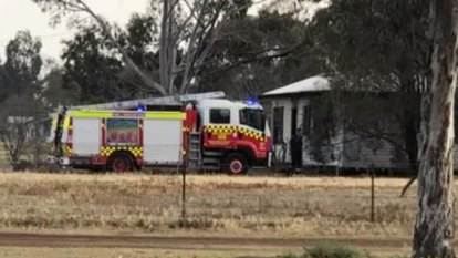 Man in custody after woman and child die in NSW house fire