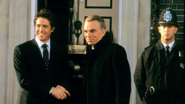 Tough love for an ally: A scene from Love Actually involving Hugh Grant as British PM and Billy Bob Thornton as US President.