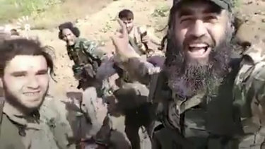 The video shows abuse of a slain female fighter by Turkish forces.