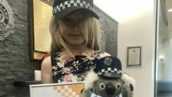 Girl who rang 000 after dad found unconscious awarded