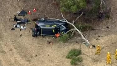 A woman has died and a baby is in hospital after a crash on a notorious stretch of road west of Melbourne.