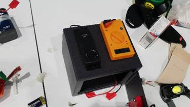 The device/item that the man had with him at the Brisbane Airport incident.