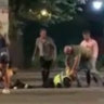 Four charged after police officer 'ragdolled' by 'pack of animals' during St Kilda arrest