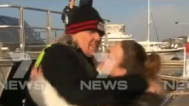 The man is reunited with his family after spending a night on the bay.