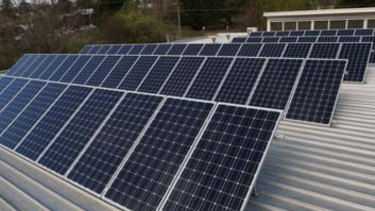 Solar panels and batteries on classrooms are expected to save thousands of dollars a year in electricity costs.