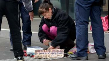 Police check a beggar's bowl in Melbourne.