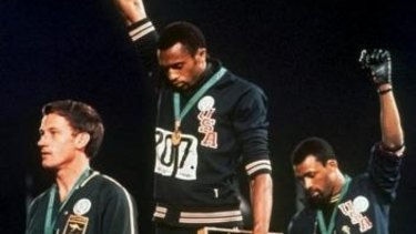 """Australia's Peter Norman (left) joins American athletes Tommie Smith and John Carlos on the podium during the famous """"Black Power"""" demonstration in 1968."""