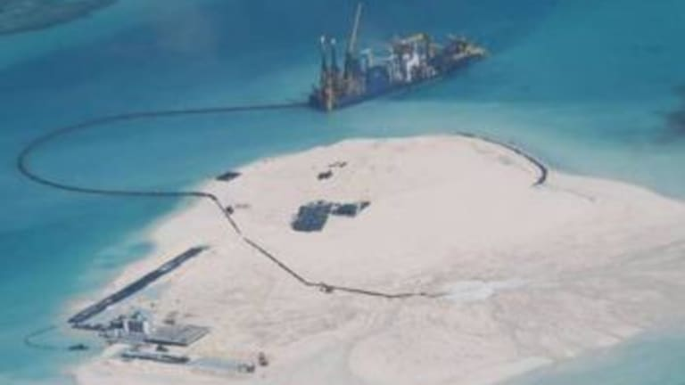 A photo released by the Philippines foreign ministry showing what Manila says are expanded structures on Johnson South Reef in the South China Sea, which is held by China.