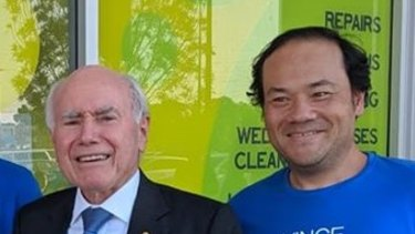 Former WA Liberal candidate Christopher Tan with former Prime Minister John Howard.