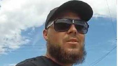 Darren Butler is one of two men with an outstanding warrant for murder.