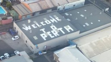 """The """"Welcome to Perth"""" sign on a rooftop in Sydenham, Sydney."""