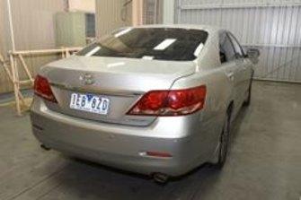 Mr Lim's car, a silver Toyota sedan.