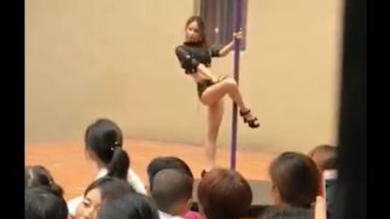 Chinese kindergarten welcomes kids with a pole dancer