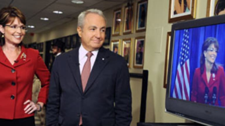 Sarah Palin stands next to producer Lorne Michaels during her appearance on Saturday Night Live in New York. He is the most awarded Emmy winner in history.