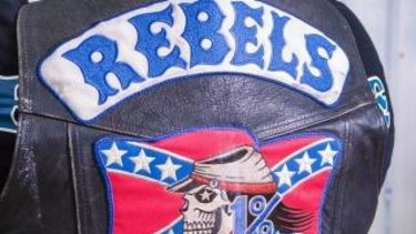 Rebels bikie one of four people charged over alleged extortion