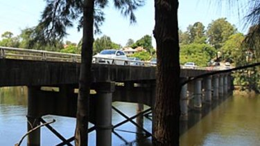 A woman was allegedly thrown from the Windsor bridge into the Hawkesbury River on Sunday.