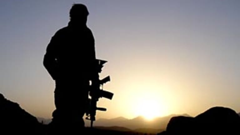 An Australian Special Operations Task Group soldier observing the valley during the Shah Wali Kot Offensive in Afghanistain in 2010.