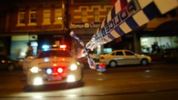A woman was charge with allegedly throwing a television at police in Woolloomooloo.