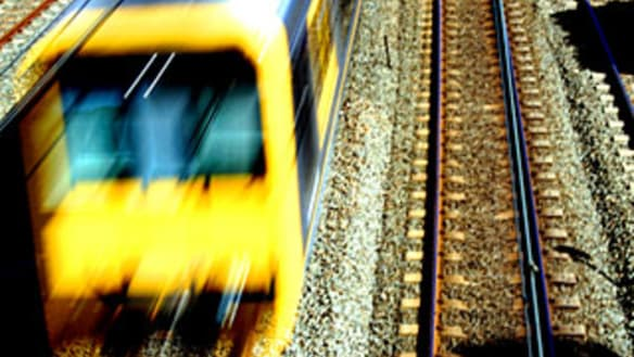 Man dies, woman seriously injured in car hit by train in NSW